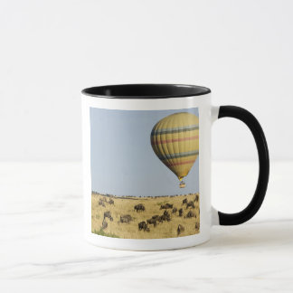 Kenya, Masai Mara. Tourists ride hot air balloon Mug