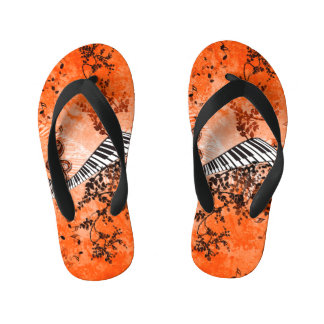 Keyboard and clef with roses flip flops