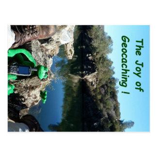 Kicking back on a rocky trail by a river postcard