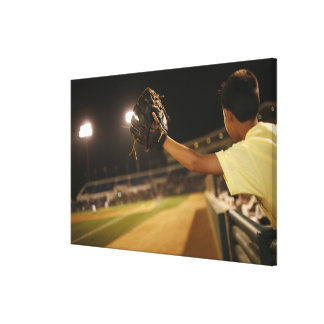 Kid leaning over wall to try and catch 'foul stretched canvas print
