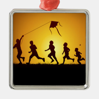 Kids flying a kite christmas ornament