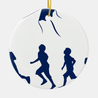 Kids flying a kite. christmas ornament