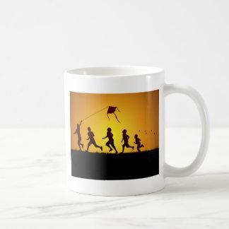 Kids flying a kite coffee mug