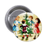 Kids playing around the decorated christmas tree pinback button