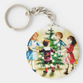 Kids playing around the decorated christmas tree key chains