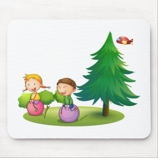 Kids playing with the bouncing balloons near the p mouse pad