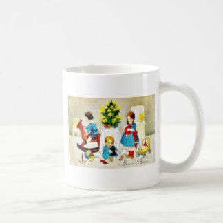 Kids playing with toys and christmas tree coffee mugs