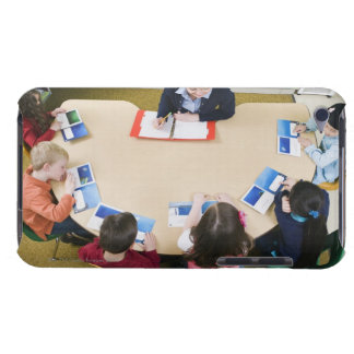Kindergarten students sitting at table with barely there iPod case