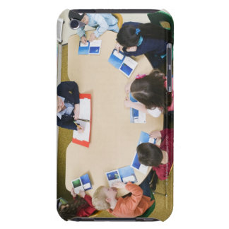 Kindergarten students sitting at table with iPod Case-Mate cases