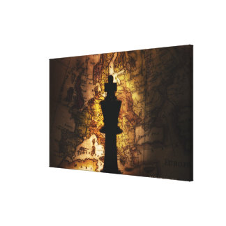 King chess piece on old world map gallery wrapped canvas