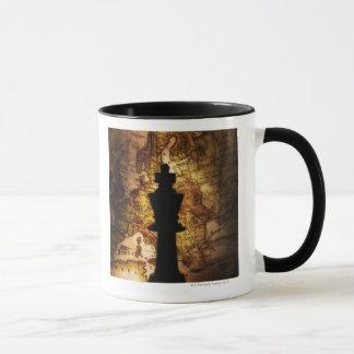 King chess piece on old world map mug