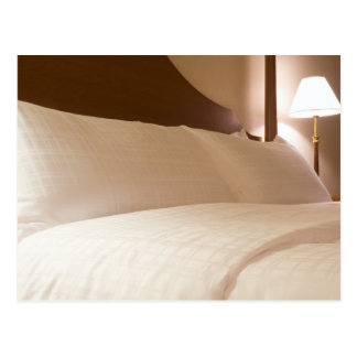 King sized bed in a hotel suite room postcard
