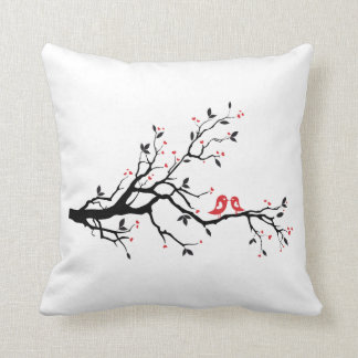 Kissing bird on tree branch with red heart leaves cushion
