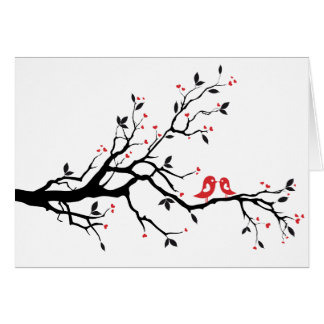 Kissing bird on tree branch with red heart leaves greeting card