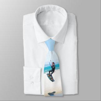 Kitesurfer boosts an air tie