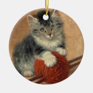 Kitten and muffler round ceramic decoration