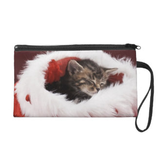 Kitten asleep in Christmas hat Wristlet