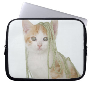 Kitten covered in yarn laptop sleeve