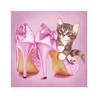 Kitten in purple shoe canvas print