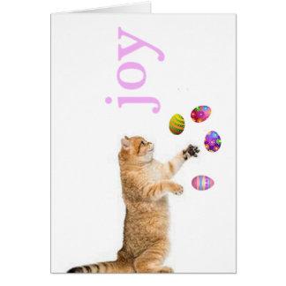 Kitten juggles Easter eggs Greeting Card