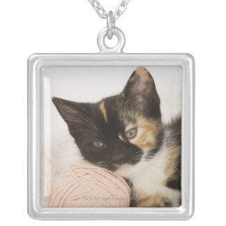 Kitten laying on ball of string silver plated necklace