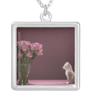 Kitten looking at vase of roses silver plated necklace