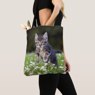 Kitten Running Through Clover Tote Bag