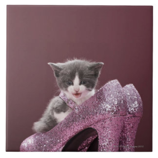 Kitten sitting in glitter shoes large square tile