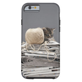 Kitten sitting on pile of newspapers tough iPhone 6 case