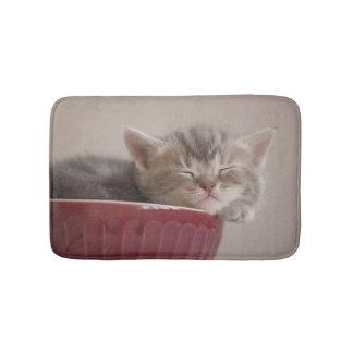 Kitten Sleeping In A Bowl Bath Mat
