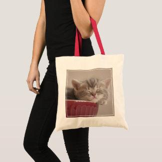 Kitten Sleeping In A Bowl Tote Bag