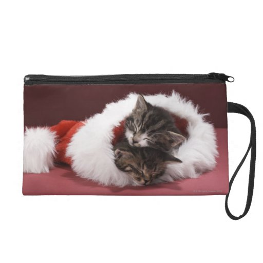 Kittens asleep together in Christmas hat Wristlet