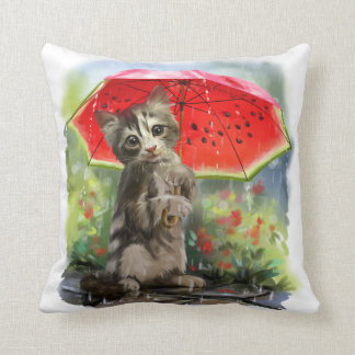Kitty holds a red umbrella throw pillow