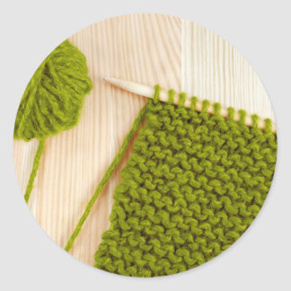 Knitting with green wool classic round sticker