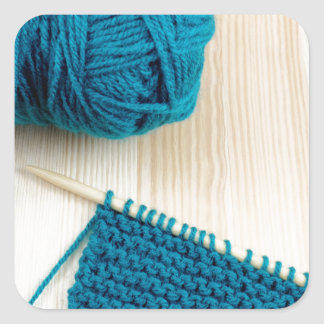 Knitting with teal yarn square sticker