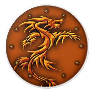 Knob with a raised, dragon design