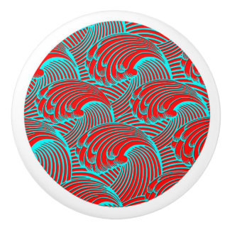 Knob with red blue wave design