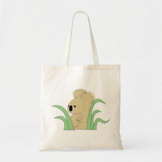 koala in eucalyptus tote tote bags