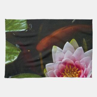 koi  swimming around lotus towel