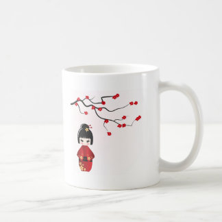 Kokeshi doll under sakura branch coffee mug