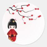 Kokeshi doll under sakura branch round stickers