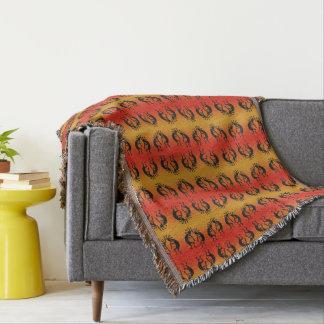 Kokopelli Southwest Pattern Black And Orange Throw Blanket