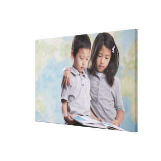 Korean children reading book near map gallery wrapped canvas