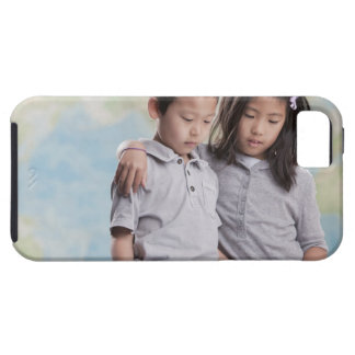 Korean children reading book near map iPhone 5 cover