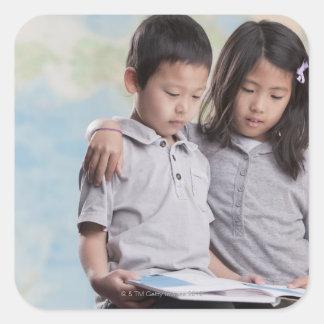 Korean children reading book near map square sticker
