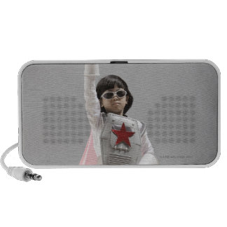 Korean girl in superhero costume with arm raised speaker system