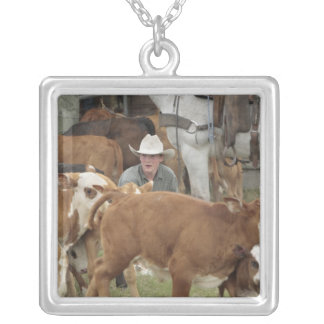 Kyle waiting with calf during round-up, silver plated necklace
