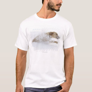 Labrador retriever running through deep snow T-Shirt