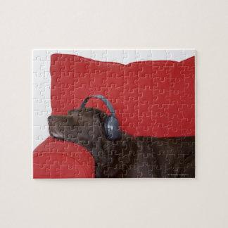 Labrador wearing headphones lying on sofa jigsaw puzzle