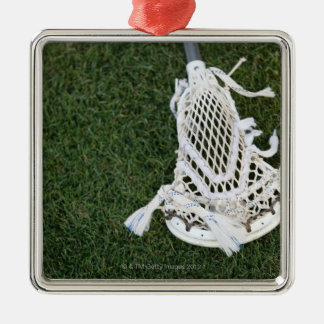 Lacrosse stick on grass Silver-Colored square decoration